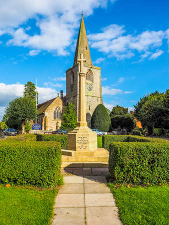 TANWORTH IN ARDEN, UK - SEPTEMBER 25, 2015: The Village Green with St Mary Magdalene church and war memorial (HDR) Editorial