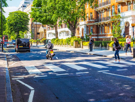 album cover: LONDON, UK - JUNE 10, 2015: Abbey Road zebra crossing made famous by the 1969 Beatles album cover (HDR) Editorial