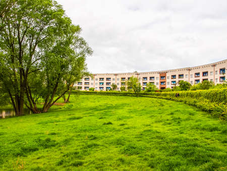 BERLIN, GERMANY - MAY 11, 2014: The Hufeisensiedlung (meaning Horseshoe housing estate) aka Grosssiedlung Britz designed by Bruno Taut and Martin Wagner in 1925 is a masterpiece of early modernism (HDR)