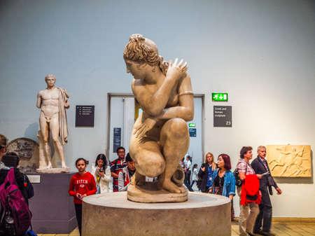 aphrodite: LONDON, UK - CIRCA JUNE, 2013: Tourists visiting an ancient statue of Venus Aphrodite goddess of love at the British Museum (HDR)