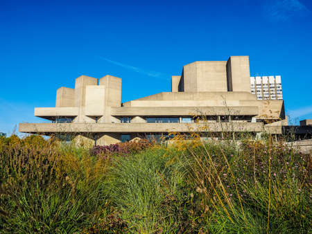sir: LONDON, UK - SEPTEMBER 28, 2015: The National Theatre designed by Sir Denys Lasdun is a masterpiece of new brutalist architecture (HDR)