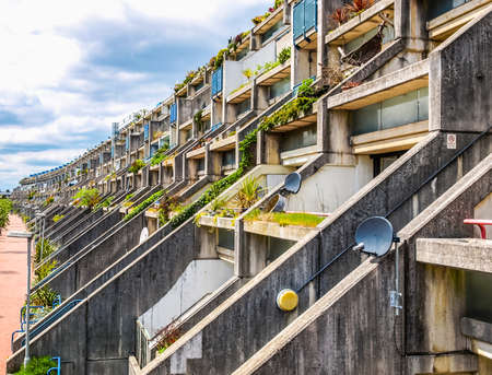 public housing: LONDON, ENGLAND, UK - MAY 06, 2010: The Alexandra Road estate designed in 1968 by Neave Brown applies the terraced house model to high-density public housing is a masterpiece of new brutalist architecture (HDR) Editorial