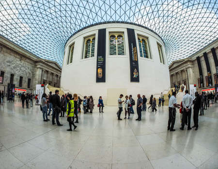 foster: LONDON, UK - SEPTEMBER 28, 2015: Tourists in the Great Court at the British Museum designed by architect Lord Norman Foster opened in year 2000 seen with fisheye lens (HDR)