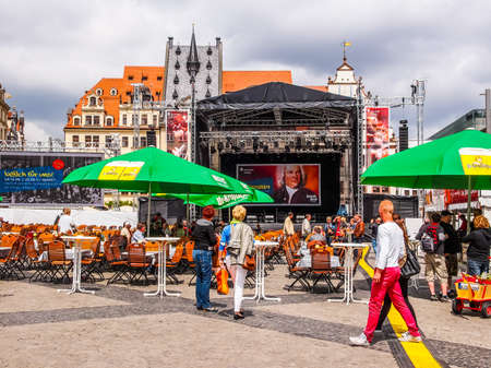 biergarten: LEIPZIG, GERMANY - JUNE 14, 2014: People at the Bachfest annual summer music festival celebrating baroque musician Johann Sebastian Bach in his town (HDR)