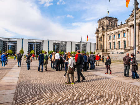 bundes: BERLIN, GERMANY - MAY 09, 2014: People visiting the Band des Bundes complex of government buildings near the Reichstag (German parliament) build in 1995 following the reunification of Germany (HDR)