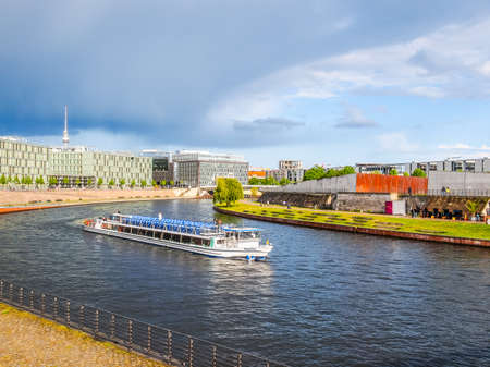 spree: BERLIN, GERMANY - MAY 11, 2014: Boats on the Spree River (HDR)