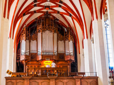 LEIPZIG, GERMANY - JUNE 12, 2014: Organist playing in the Thomaskirche St Thomas Church where Johann Sebastian Bach worked as a Kapellmeister and the current location of his remains (HDR)