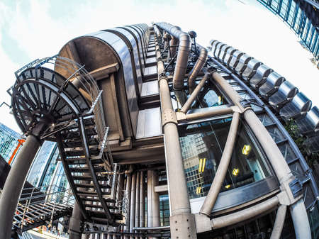 LONDON, UK - SEPTEMBER 29, 2015: Lloyd of London is an iconic high tech skyscraper designed by architect Richard Rogers seen with fisheye lens (HDR)
