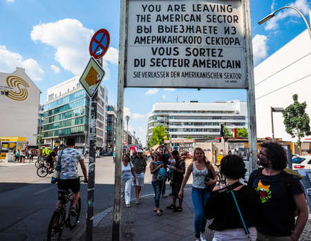 checkpoint: BERLIN, GERMANY - CIRCA JUNE 2016: Checkpoint Charlie (aka Checkpoint C) wall crossing point between East Berlin and West Berlin during the Cold War (HDR)