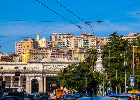 GENOA, ITALY - MARCH 16, 2014: Heavy vehicle and pedestrian traffic in front of Piazza Principe main railway station (HDR)