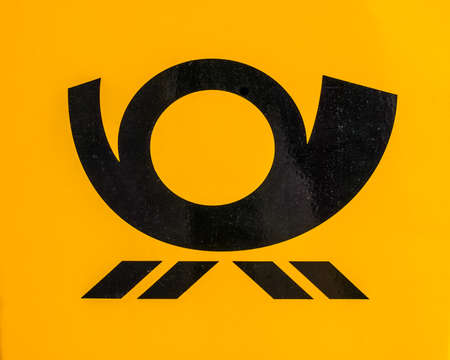 LEIPZIG, GERMANY - JUNE 11, 2014: Deutschepost symbol on a mail delivery vehicle (HDR)