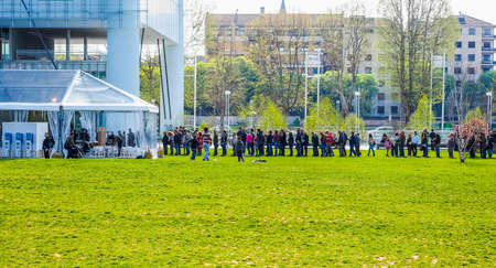 TURIN, ITALY - APRIL 11, 2015: People queueing to visit the new Intesa San Paolo skyscraper designed by Renzo Piano Building Workshop which just opened today and is the highest building in Turin (HDR)