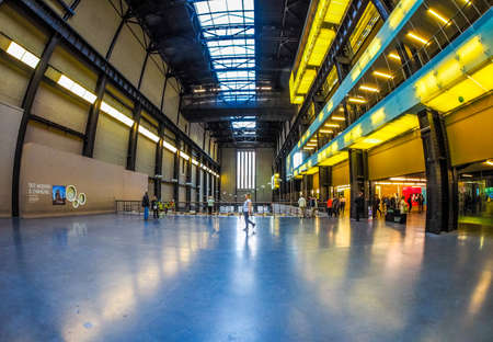 public space: LONDON, UK - SEPTEMBER 28, 2015: The Turbine Hall once housed the electricity generators of the power station now a public space part of Tate Modern art gallery in South Bank seen with fisheye lens (HDR)