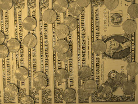 see the usa: One cent coins and One Dollar banknotes  currency of the United States useful as a background - vintage sepia look Stock Photo