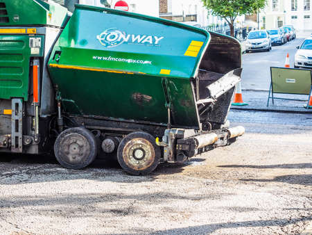 asphalt paving: LONDON, UK - SEPTEMBER 29, 2015: Paver aka paver finisher or asphalt finisher paving machine construction equipment used to lay asphalt on roads (HDR) Editorial