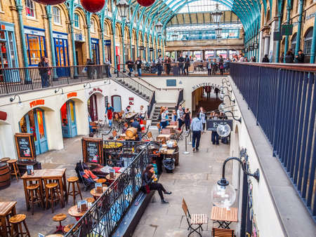 LONDON, ENGLAND, UK - OCTOBER 23: Tourists visiting the world famous Covent Garden on October 23, 2013 in London, England, UK (HDR) Editorial