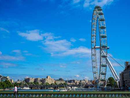 aeronautical: LONDON, UK - JUNE 10, 2015: The London Eye ferris wheel on the South Bank of River Thames aka Millennium Wheel built in 1999 using advanced aeronautical engineering know how by British Airways (HDR)