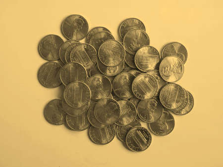 Dollar coins 1 cent currency of the United States - vintage sepia look