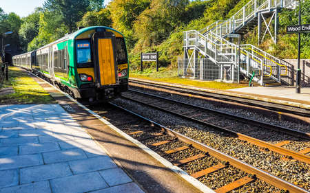 wood railway: TANWORTH IN ARDEN, UK - SEPTEMBER 25, 2015: London Midland train at Wood End railway station on the Stratford upon Avon to Birmingham route known at the Shakespeare Line (HDR) Editorial
