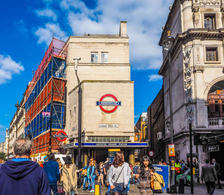 leicester: LONDON, UK - JUNE 10, 2015: Travellers at Leicester Square underground station (HDR) Editorial