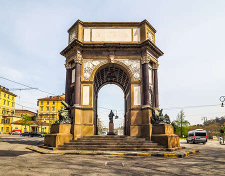 dedicated: TURIN, ITALY - CIRCA APRIL 2016: Arco del Valentino (meaning Arch of Valentino park) dedicated to the artillery designed by Pietro Canonica in 1930 (HDR)