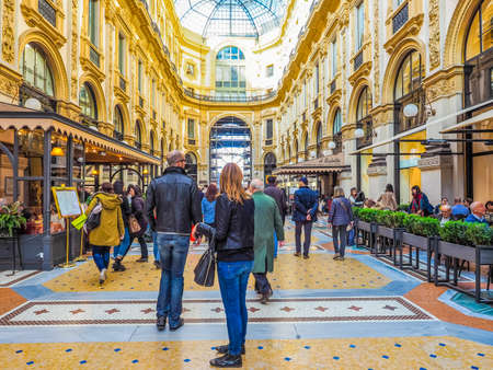restored: MILAN, ITALY - MARCH 28, 2015: People visiting the newly restored Galleria Vittorio Emanuele II (HDR) Editorial