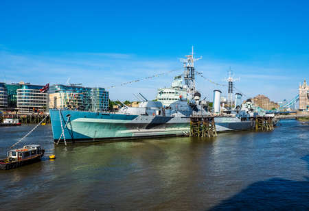 permanently: LONDON, UK - JUNE 11, 2015: HMS Belfast ship originally a Royal Navy light cruiser is now permanently moored on the River Thames as a museum ship (HDR)