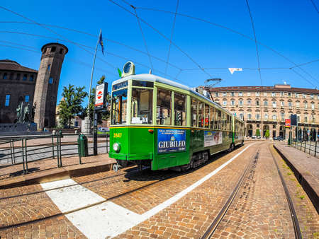 TURIN, ITALY - CIRCA SEPTEMBER, 2015: A vintage historical green tramway seen with fisheye lens (HDR) Editorial