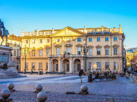 verdi: TURIN, ITALY - OCTOBER 22, 2014: People seated in front of Conservatorio Giuseppe Verdi music school (HDR)