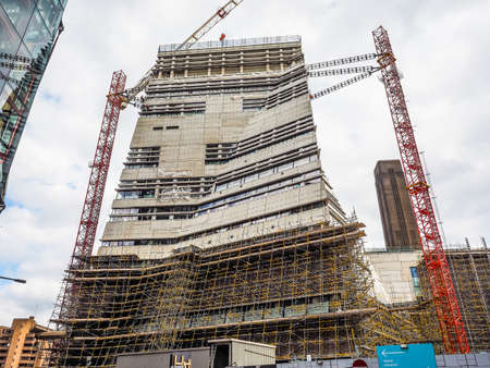 powerstation: LONDON, UK - JUNE 10, 2015: Extension to the Tate Modern art gallery in South Bank powerstation designed by Swiss architects Herzog and De Meuron (HDR) Editorial