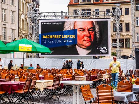 beer garden: LEIPZIG, GERMANY - JUNE 14, 2014: People in beer garden at the Bachfest annual summer music festival celebrating baroque musician Johann Sebastian Bach in his town (HDR)