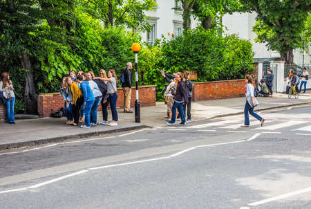 zebra crossing: LONDON, UK - JUNE 10, 2015: Abbey Road zebra crossing made famous by the 1969 Beatles album cover (HDR) Editorial