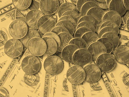 see the usa: Dollar coins and banknotes  currency of the United States useful as a background - vintage sepia look