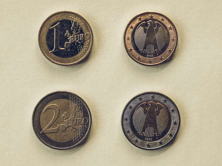 geld: Vintage looking One and Two Euro coins currency of the European union common side and German side