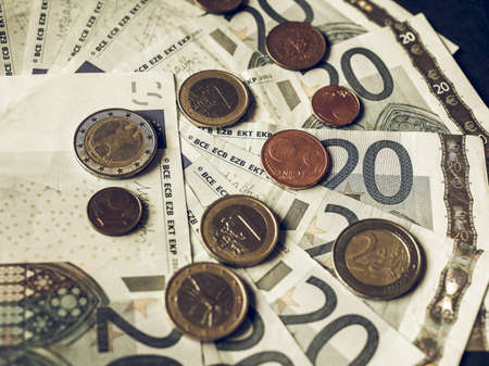 Vintage looking Twenty Euro banknotes and coins currency of Europe