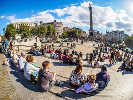 trafalgar: LONDON, UK - SEPTEMBER 27, 2015: Tourists in Trafalgar Square (HDR) Editorial