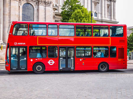 LONDON, ENGLAND, UK - JUNE 18: Traditional double decker red bus on June 18, 2011 in London, England, UK (HDR)