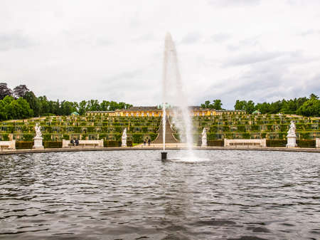 frederick: POTSDAM, GERMANY - MAY 10, 2014: Tourists visiting the baroque Schloss Sanssouci former summer palace of Frederick the Great King of Prussia (HDR)