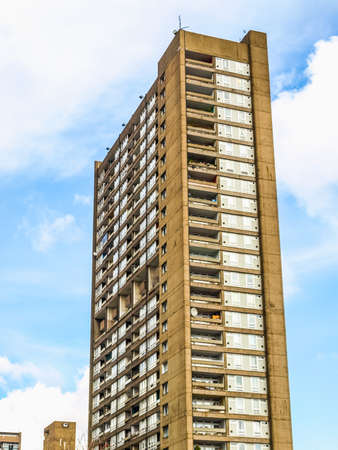 hamlets: LONDON, ENGLAND, UK - MARCH 05, 2009: The Balfron Tower designed by Erno Goldfinger in 1963 is a Grade II listed masterpiece of new brutalist architecture (HDR)