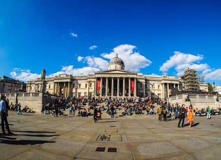 trafalgar: LONDON, UK - SEPTEMBER 27, 2015: Tourists in Trafalgar Square in front of the National Gallery (HDR)