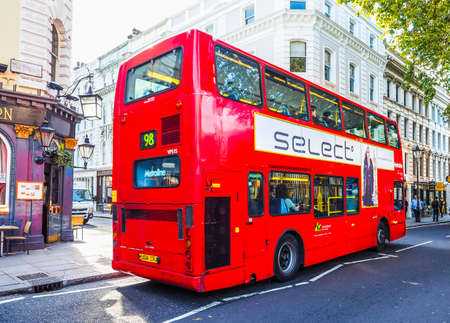double decker: LONDON, UK - SEPTEMBER 28, 2015: Red double decker bus for public transport in central London (HDR)