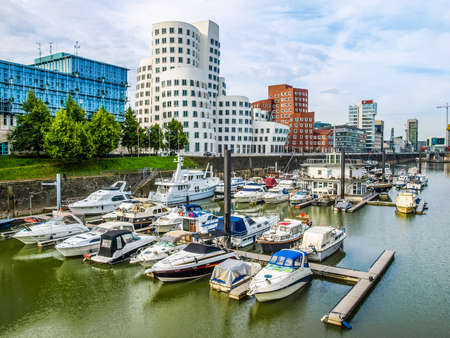 docklands: DUESSELDORF, GERMANY - AUGUST 3, 2009: The new Medienafen is a redevelopment area in the former docklands and harbour with buildings designed by Steven Holl, David Chipperfield and Frank O Gehry (HDR) Editorial