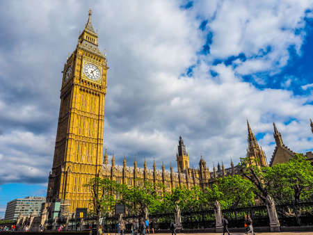 parliament square: LONDON, UK - JUNE 09, 2015: Tourists in Parliament Square in Westminster (HDR) Editorial