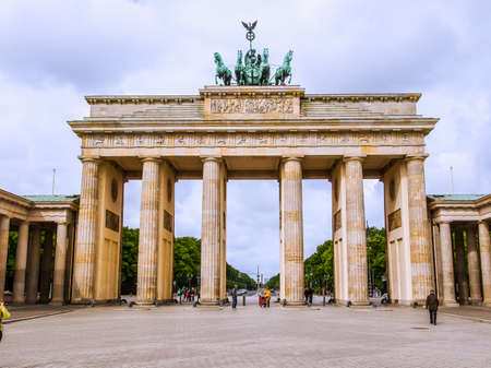 BERLIN, GERMANY - MAY 11, 2014: Tourists visiting the Brandenburger Tor (Brandenburg Gate) linking East and West Berlin (HDR) Editorial