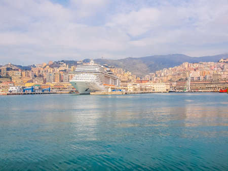 GENOA, ITALY - MARCH 16, 2014 - Since the construction of the new merchant harbour the old harbour called Porto Vecchio is still used for cruise ships and small boats (HDR)