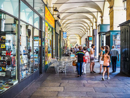 via: TURIN, ITALY - JUNE 19, 2015: Tourists in Via Po ancient central baroque street (HDR)