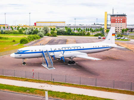 turboprop: LEIPZIG, GERMANY - JUNE 14, 2014: Ilyushin IL-18 aka Coot large turboprop Soviet airliner aircraft from 1957 in display in front of Flughafen Leipzig Hall airport (HDR) Editorial