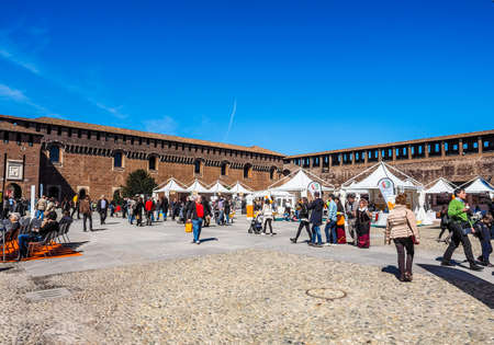 sforzesco: MILAN, ITALY - MARCH 28, 2015: People visiting the Sforza Castle aka Castello Sforzesco which is the oldest castle in town (HDR) Editorial