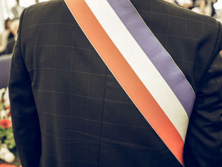 mayoral: Vintage looking Mayor of French town with French tricolour flag mayoral sash