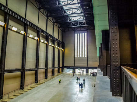 public space: LONDON, UK - CIRCA MARCH, 2009: The Turbine Hall which once housed the electricity generators of the power station is now a huge open public space part of Tate Modern art gallery in South Bank (HDR) Editorial